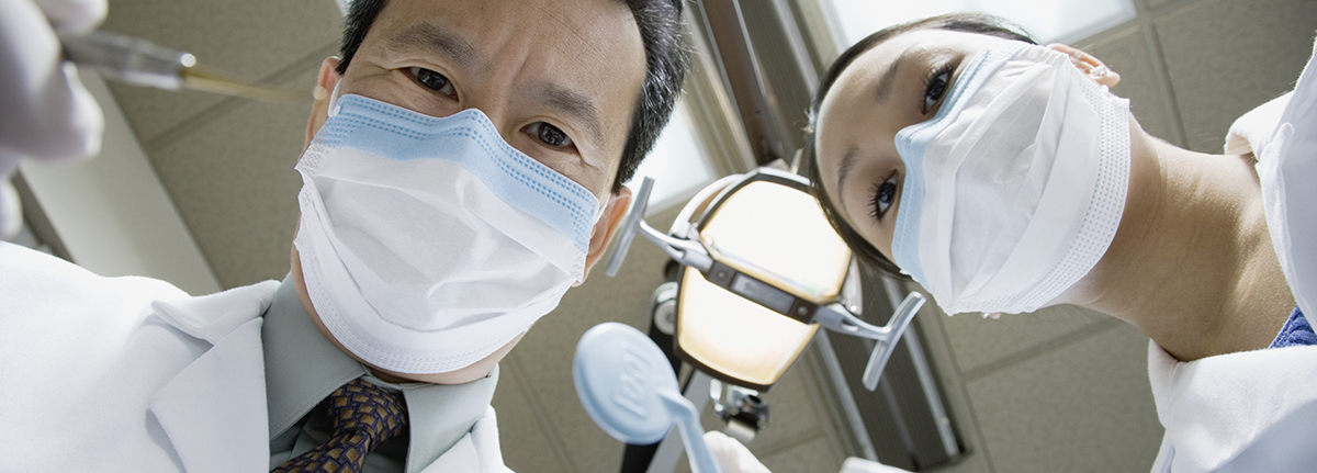 Two Dentists with Surgical Masks